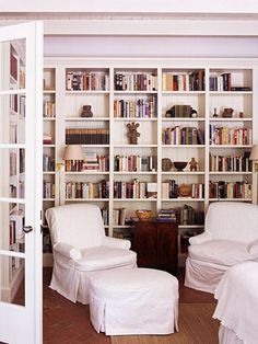 White slipcovers and a built in bookcase