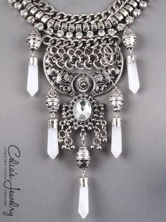 * Nickel and Lead Safe  * Rhinestone Accent  * Stud    BURNISHED SILVER TONE  WHITE STONE ACCENT  3IN EXTENDER  Materials: Metal  Length: 14 inch  Weight: 4.4 oz  