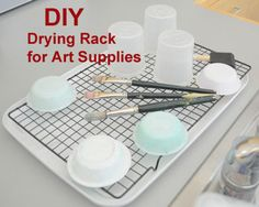 DIY Drying Rack - The Eric Carle Museum of Picture Book Art cooling rack and plastic lid Kids Food Crafts, Art Lessons Elementary, School Lessons, Art Classroom, Classroom Ideas, Teaching Art, Teaching Ideas, Craft Room Storage, Learn Art