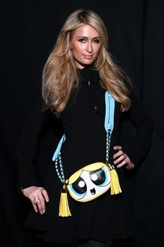 Paris Hilton Photos Photos - Paris Hilton poses for a photo backstage at the…