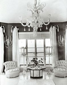 A new house on Long Island, New York, was the first of nine collaborations between Frances Cheney and George Stacey. With its navy blue walls, gray lacquer floor, simple white curtains, crystal chandelier, satin slipper chairs, and sybaritic fur rugs, the master suite exuded a crisp, modern glamour. Town & Country, August 1936; A publication of Hearst Communications, Inc