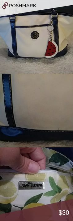 Giani Bernini purse. Cream and blue purse. Used but in great condition. Look at picture of the back of purse. Has rubbed unto clothes, but it can be cleaned. Bags Shoulder Bags