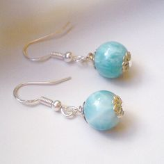 Larimar earrings round beads I made these pair of Larimar earrings with Larimar round beads mm Pretty blue colors and creamy swirls silver tone findings sterling silver earrings hooks For