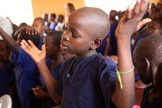 Children praying by my friend Alyson Willis
