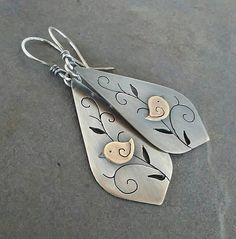 I made this sweet pair of bird earrings by hand using sterling silver and brass. They measure 2 inches in length from the top of the ear wire to the bottom of the dangle. They have been oxidized to show detail and add rustic charm. Jewelry Ideas, Jewelry Design, Copper Sheets, Bird Earrings, Handmade Ideas, Hobby, Rustic Charm, Mixed Metals, Bird Feathers