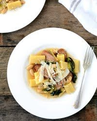 Sausage, escarole, and white beans join chunky rigatoni in a garlicky broth slightly thickened with Parmesan. Don't stir too much after adding the beans, or they'll break up. Fast Weekday PastasRecipe from: Quick From Scratch One-Dish Meals Cookbook