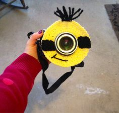 Minion Camera lens buddy.  Crochet camera critter by mandag433