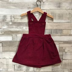 As part of our Christmas 2017 collection is this red pinafore dress, made from a rich red/ maroon colour corduroy. Perfectly paired with our tartan Peter Pan collar blouse for a beautiful girls Christmas outfit. This red corduroy pinafore is not only perfect for Christmas, its also a
