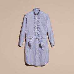 A striped cotton shirt dress defined by an Elizabethan-inspired ruffle at the collar and placket. A waist belt balances the relaxed cut and softly puffed sleeves.