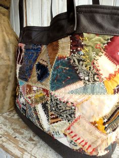 LARGE PATCHWORK TOTE - This bag was made from a Victorian Era crazy quilt, complete with all the beautiful Victorian textiles, silk, velvet, brocades. The detail in this piece is absolutely amazing, all the hand stitching and hand embroidery, I could just stare at it for hours! Someone spent ALOT of time making this quilt!! I salvaged the parts that were in better condition and re-patched some pieces. Please look closely at the pictures as there are some time worn areas, places where the…