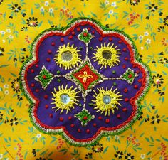 Drapes for Half-Tester.  Embroidered piece with shisha embroidery. Yellow and purple piece detail.
