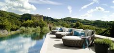 Day bed Tosca next to pool outdoor pillows from Tribu. Love the furniture, love the scenery !