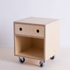 Bedside cabinet/ table with drawer on lockable castors with circle handle cutout sing Birch plywood and made locally