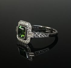 platinum mounted green tourmaline and diamondArt Deco style cluster ring. Made in Chichester, England. 3 Stone Rings, Wide Band Rings, Green Diamond, Diamond Art, Chichester England, 3 Stone Engagement Rings, Gold Feathers, Bespoke Jewellery, Dress Rings