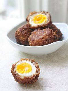 LC, GF ~ Scotch Eggs: 7 large eggs  1 tube of breakfast sausage  1/4 c parmesan cheese  1/4 c coconut flour  S & P  1/4 tsp garlic powder  1 egg, beaten  oil for frying