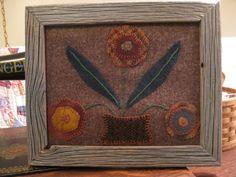 Framed wool applique piece