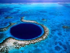 Great Blue Hole, Belize- a big, circular hole in the ocean that desends over 500 ft deep