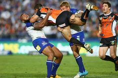 Ben Murdoch-Masila of the Tigers is tackled during the round eight #NRL match between the Bulldogs and the Wests Tigers at ANZ Stadium on May 3, 2013 in Sydney, Australia.