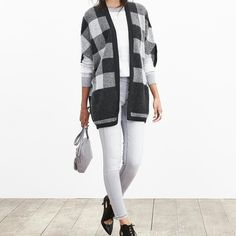 Buffalo Check Cardigan BRAND NEW WITHOUT TAGS! Never worn!! Black/gray/white, fuzzy buffalo check pattern. Purchased at the beginning of the fall season and never worn. Make it yours! More photos to come.. Banana Republic Sweaters Cardigans