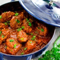Cape Malay Chicken Curry Recipe Main Dishes with onions, oil, coriander seeds, pepper flakes, fennel, ground cumin, ginger, tumeric, black pepper, cardamom pods, cinnamon, garam masala, crushed tomatoes, chicken pieces, garlic, brown sugar, lemon juice, salt