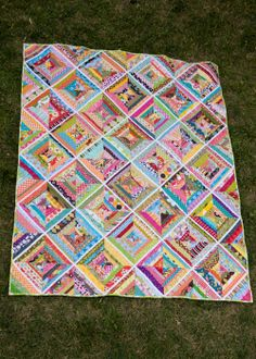 I like the narrow white strips to start the block. from the blue chair:  strings quilt layout
