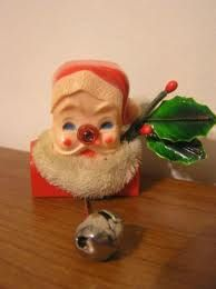 a close up of the Christmas Santa pin. Pull the string with the bell on it and Santa's nose lights up. Ahh...those were the days.