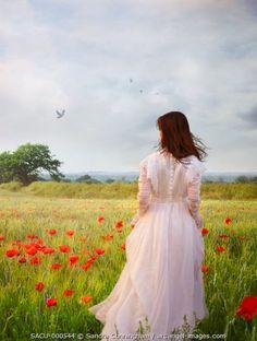 www.arcangel.com - woman-walking-in-fields-of-poppies