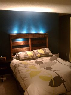 headboard made from an old pallet with some electricity ran through it
