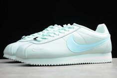 Designed by Nike co-founder Bill Bowerman, the Nike Cortez has been continuously produced since it debuted in This iconic running sneaker features a leather or nylon upper, EVA midsole, and solid rubber outsole with a classic herringbone pattern. Running Sneakers, Sneakers Nike, Nike Classic Cortez, Herringbone Pattern, Nike Cortez, Grey And White, Leather, Shoes, Runway Shoes