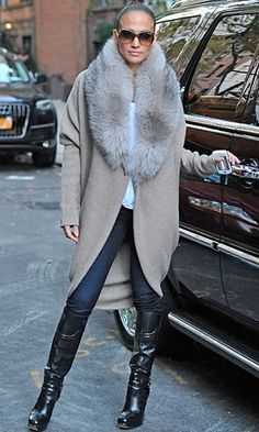 Jennifer Lopez in a large fur collar cardigan with jeans and knee-high boots...Im Sooo in LOVE with this coat!