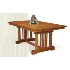 The Crestline trestle table is shown in quarter sawn white Oak with optional 6 inch clipped corner and a beveled edge. Standard features include a square corner with a mission edge and 1 inch thick top. The spreader bar between the trestle on a 66 inch or 72 inch long table will be 42 inches.