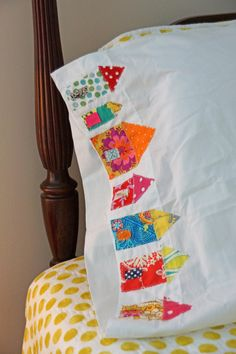 little houses on pillow cases. great way to use fabric scraps.