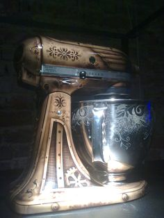 I've wanted a customized Kitchen Aid mixer our entire marriage. Only problem is that I could never settle on how I wanted it customized. I've chosen. I want a steampunk theme, similar to this. More gears though. And maybe a suggestion of brain hidden within. =) I'll sketch it up for you, Spouse. ;)