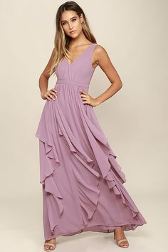 The Simply Sweet Mauve Maxi Dress is the dress you've been dreaming of! Lovely chiffon shapes a gathered, princess seamed bodice with a V-neck and back. A banded waist tops a flowy maxi skirt with flaring, ruffled godets. Hidden back zipper.