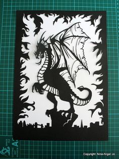 https://www.etsy.com/fr/listing/204432268/papercut-art-a4-fantasy-dragon?ref=unav_listing-same