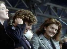 Jackie and John Jr. (Caroline at left).  Jackie seems to be enjoying herself at the dedication of the JFK Library and Museum in Boston, October 1979.