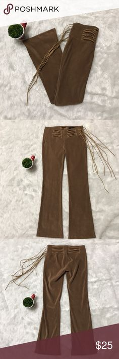 L.E.I Pants L.E.I Pants with strings coming around the waist there's also a zipper on the side of the pants there in great condition. l.e.i Pants