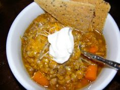 Better Homes & Garden  Squash, Chickpea, and Red Lentil Stew  1 lb butternut squash, or pumpkin  1  15 ounce can of chickpeas, rinsed and drained  3 medium carrots, cut into 1/2 inch pieces  1 cup chopped onion  1 cup red lentils  2 tablespoons tomato paste  1 tablespoon grated fresh ginger  1 tablespoon lime juice  1 teaspoon cumin  1/4 teaspoon tumeric  1/4 teaspoon salt  1/4 teaspoon black pepper  4 cups veg broth  Throw all ingredients into the slow cooker. Cook on low for 8 hours.