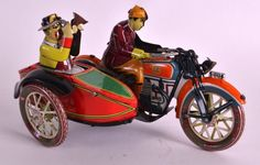 A VINTAGE TIN PLATE WIND UP LITHOGRAPH MOTORBIKE with : Lot 472