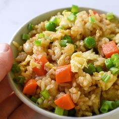Chinese fried rice made with fragrant jasmine rice, carrots, peas, and scrambled eggs. This easy stir-fried dish turns plain white rice into flavorful grains lightly seasoned with soy sauce and tossed with colorful vegetables. #friedrice #chinesefood #video