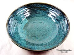 Pottery serving bowl in teal/turquoise and by Ningswonderworld. Love this color