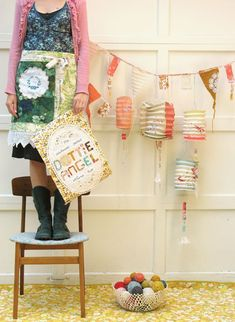 Dottie Angel - great photo styling of artist ... her work, sign/branding, cropping