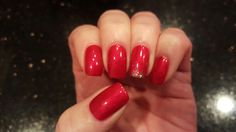 All a girl needs for Christmas is perfectly painted red nails with a little bling! Nails by Kariann!
