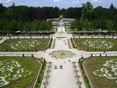 Het Loo, Netherlands. These spectacular gardens are located behind the Het Loo Palace in the Netherlands. The gardens have a Baroque design and are complete with gravel walkways, radial point, statues and fountains.