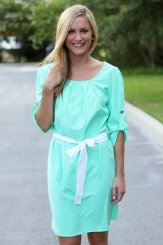 Who runs the world? Girls! Especially in this dress! We adore the tie waist, adjustable sleeves, and stunning mint color. Slip this dress on with your favorite flats and you'll be out the door in l...