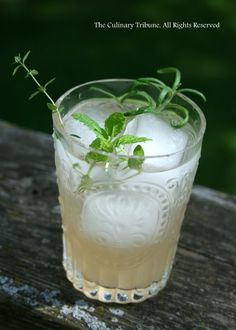 Grapefruit sour: fresh grapefruit juice, Moscato wine, sparkling water, fresh mint, thyme, rosemary, ice cubes
