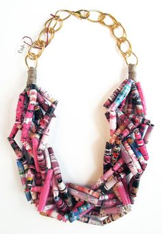 Kick off summer with this bold necklace! Each bead is handmade out of paper using decoupage technique. The necklaces are large statement pieces