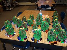 christmas tree craft with pinecones & mardi gras beads.....awesome!