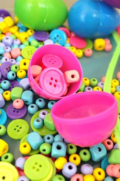 This rainbow fine motor sensory bin is perfect for spring. It is full of simple play items to inspire open ended exploration! Each item is great for strengthening little hands for future writing.