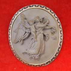 Victorian Lava Cameo Brooch/Pendant Depicting A Woman Angel Carrying Flowers And A Child Angel Bearing A Torch, In Motif After Thorvaldsen, A Danish Sculptor    c. 1855 (Cameo)   c. 1865-1875 (Mount)